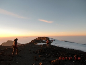 Almost there, at the very summit of Mt. Kilimanjaro: Uhuru Peak.